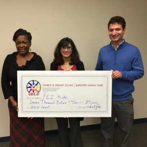 Church & Dwight research chemist Nicole Nguyen (c.) presents a check to Jesse Elliot, PEI Kids' Development and Public Relations Coordinator, and Roz Dashiell, Executive Director, at PEI Kids' Lawrenceville headquarters in November of 2015.