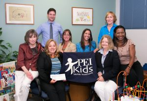 Investors Bank representatives present PEI Kids board members and staff with a donation from Investors Foundation in July 2014.