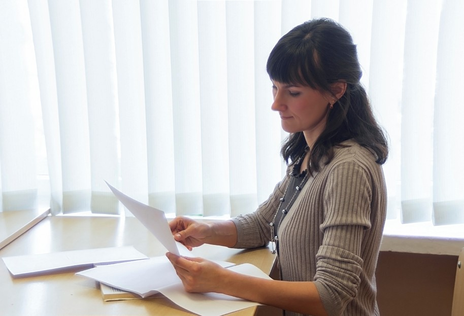 Business woman reviewing paperwork in an office